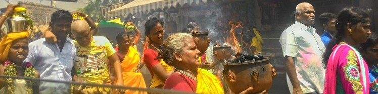 People offering their tribute by carrying  a fire pan (Thee satti - தீ சட்டி ) & milk jar