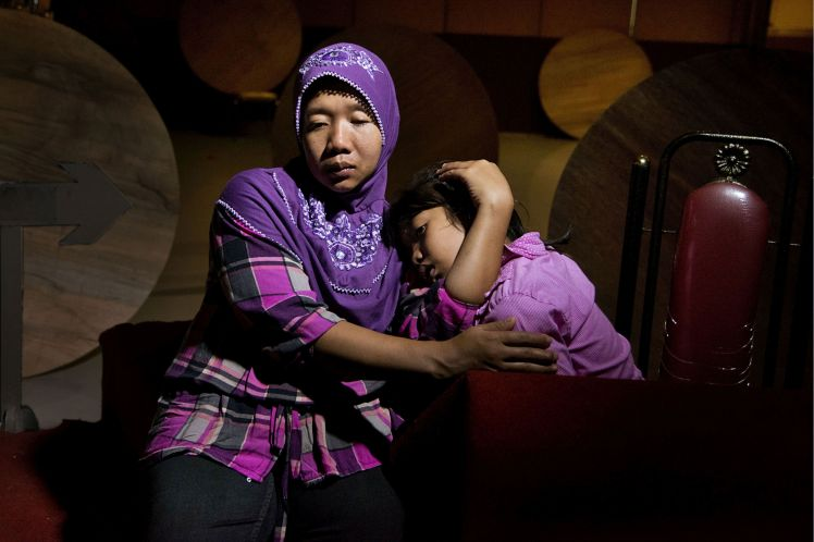 "Haryatin, now 36, from Indonesia, abused in Saudi Arabia. ""Once I had said, 'If you don't like me, please send me to the office, please send me home.' She said, 'How nice, how lucky you are to go home. If I don't like, I just hit or I kill you.'"""